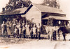Jarry Sutton Farm, Lenox, Ga., circa, 1936. L-R: 1. Dalton Bennett, 2. Evelyn (Sutton) Bennett, 3. Betty Jean Bennett, 4. Charlie Baldree, 5. Idell Baldree, 6. Leland Baldree, 7. Paul Baldree, 8. ___, 9. RC Baldree, 10. Tommy Baldree, 11. Cranford Baldree, 12. Eta Mae Baldree. 13. Lucille (Sutton) Bennett, 14. Ray Sutton, 15. Mary Beth Sutton, 16. Marcus Bennett, 17. Elsie (Baldree) Sutton, 18. Talmadge Sutton, 19. Frank Sutton, 20. Jerry Sutton, 21, Aubrey Sutton. (Courtesy of Bill Outlaw)