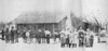 Vickers Family Homeplace. This picture made in 1914 shows neighbors, left to right, Dan Luke, Lawrence Luke and Nas Suggs, with mules, and George Paulk holding the team of oxen. The Vickers family, left to right, front row, Troy, Leta, Blanie, and Roy; back row, (left to right) Raleigh and wife, Alice Cox, Lena, Flem and Lizzie, father and mother and the black woman is Hattie who helped Mrs. Vickers with house and Children. Photo from a newspaper clipping submitted by Garthel Vickers and wife Ginny  who resided on the original homeplace of Flem Vickers, Garthel's granddaddy.  The log house had long been replaced with a more modern structure and and that too was abandoned for a modern double-wide mobile home. Original photo needed.