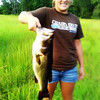 Mobile upload - Paige's biggest Bass to date - 6 pounds. She caught it at he BePa's pond in Metter, Ga
