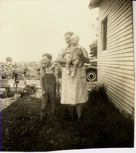Jack Jones, my great grandma Rukes holding Monty Jones.  Photographed behinc Norman and Winifred's home on Spring Creek Road, northern Vigo County.