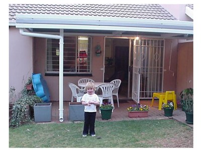Sami with Mum's New Awning  Mum got a nice new levered awning.  He we can see it, with Sami