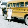 Lois beside Otranto, Iowa school bus where she went to grade school.