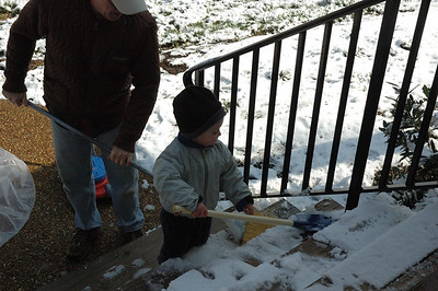 Jack helps Poppy shovel the steps out front.