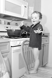 Don't interrupt me!  I'm cooking here!  BTW, the red cheek and lips are from his recent head cold.