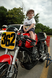 He wanted to sit on the Ducati and the kindly racer couple said sure, put him up there, don't worry about the tank.