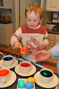 Coloring easter eggs for the Easter Bunny to hide.