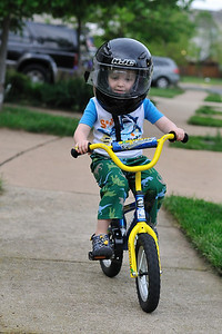 Practicing helmet-wear prior to Friday's show-and-share session at daycare.  Note tear-off taped to visor.
