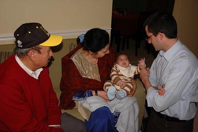 Patrick with Zeenie's parents, Tahir and Saleema; and her newest nephew, Mustafah.
