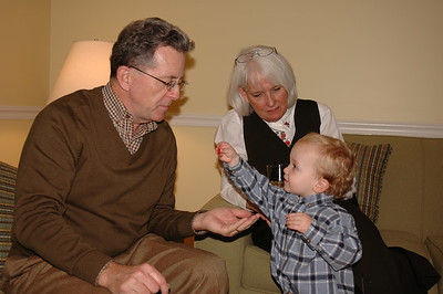 """Jack offers """"Poppy"""" an M&M at Thanksgiving dinner at Pat and Zeenie's."""