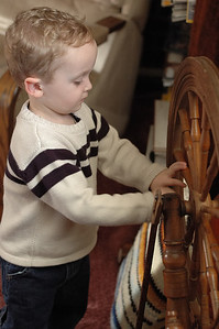 Jack checks out his great grandmother's spinning wheel.
