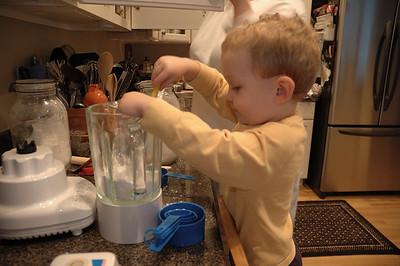 Jack helps mom make pancakes for breakfast.