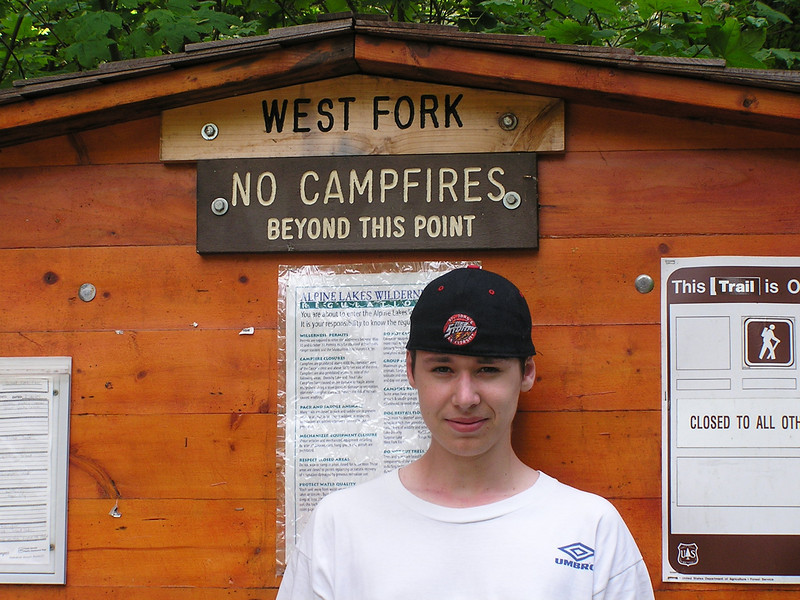 Kevin in front of the trout lake sign