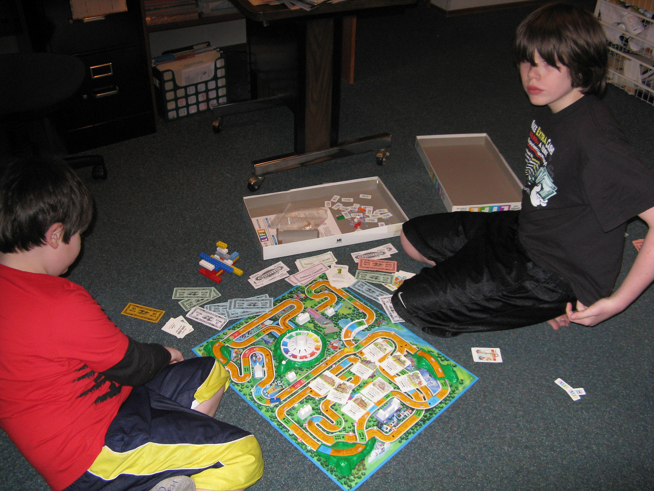 Ahh, the game of life.  (L to R) Riley and Corey.