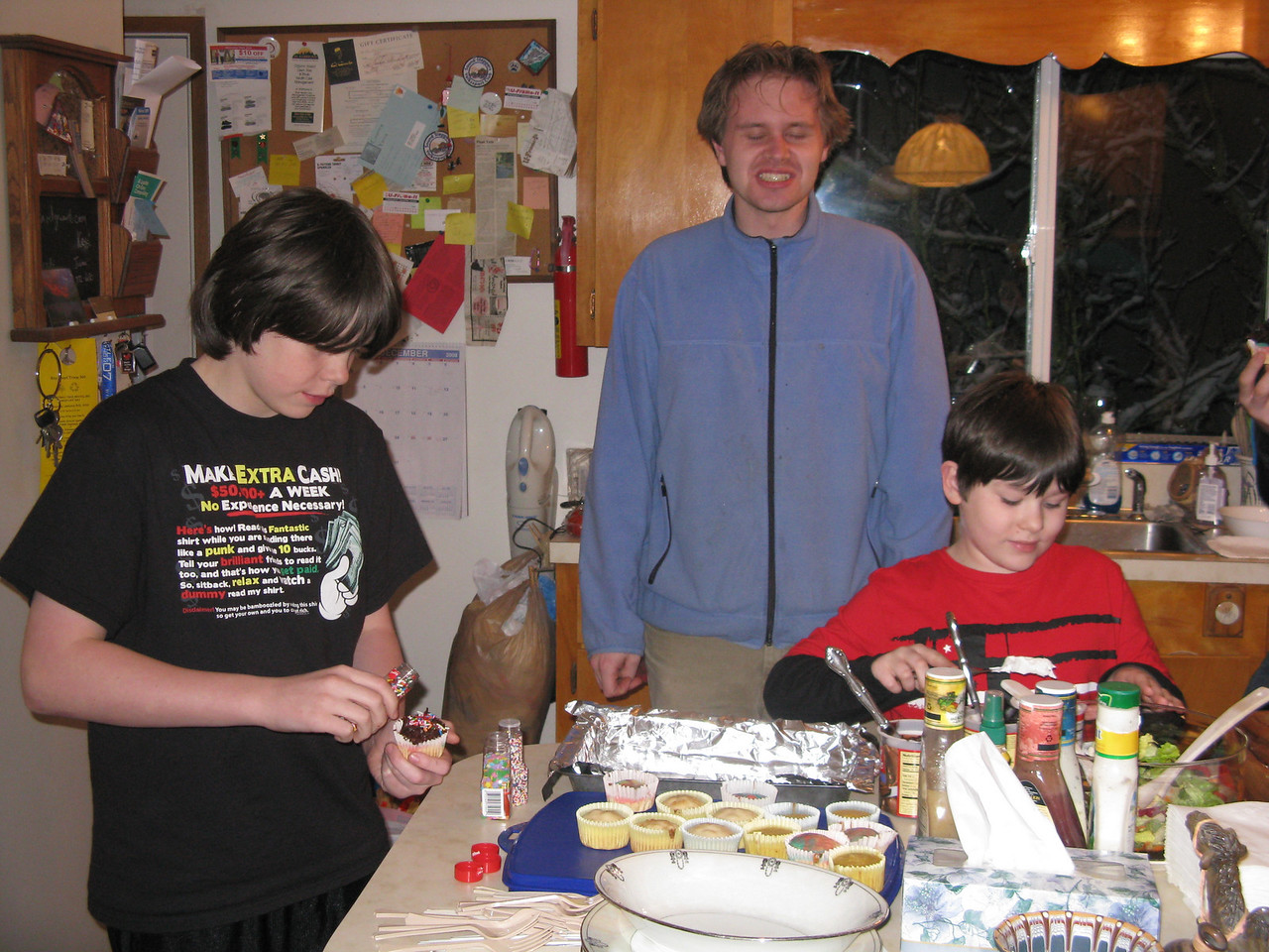 Yummmm ... cupcakes and you can put on your own frosting.  (L to R) Corey, Nathan and Riley.