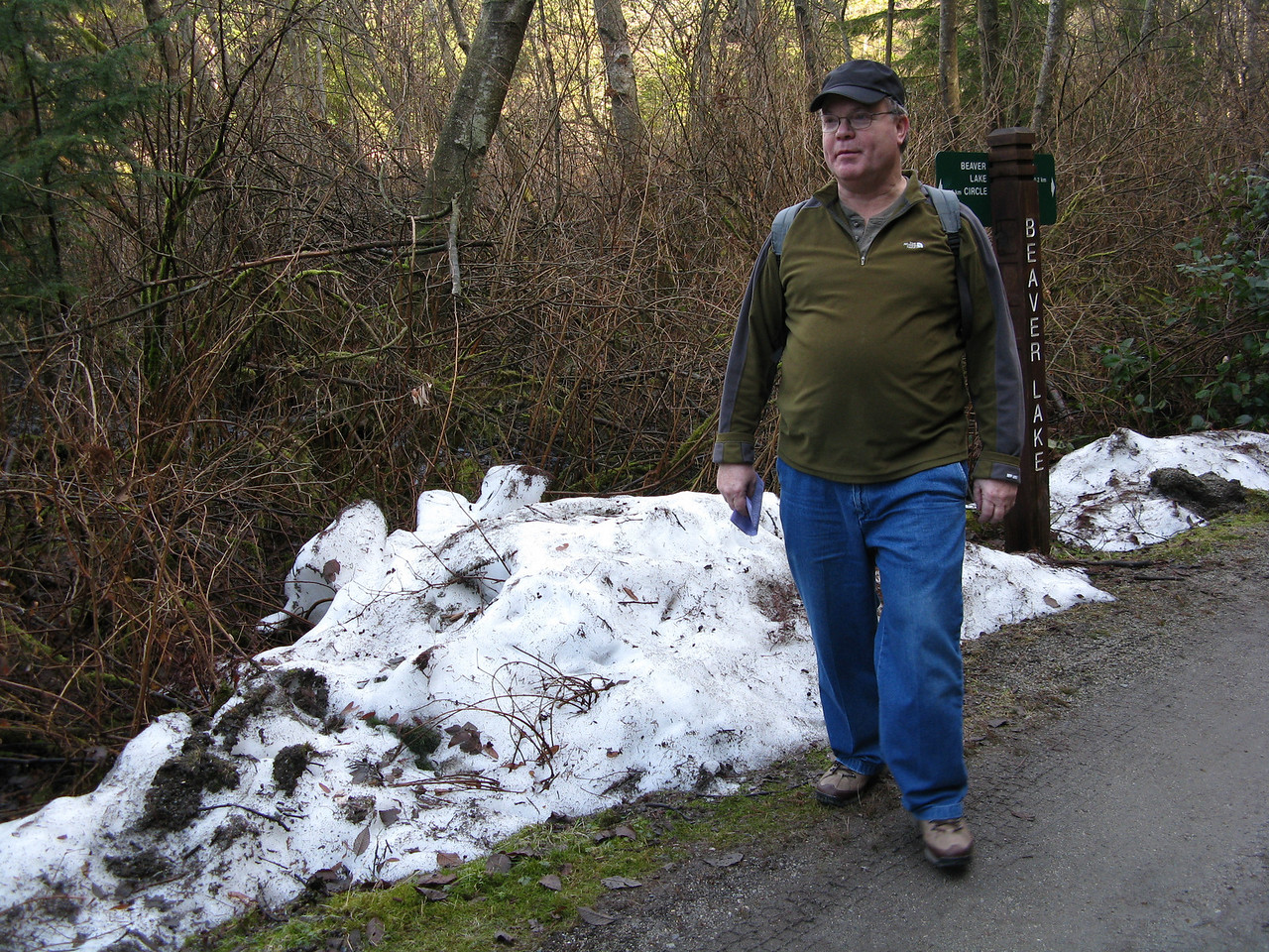 Yes, there was snow along the path in the interior of the park.  Our route had us turn left away from the water and head  across the park.  We are on the Beaver Lake Trail heading west.  Neil.