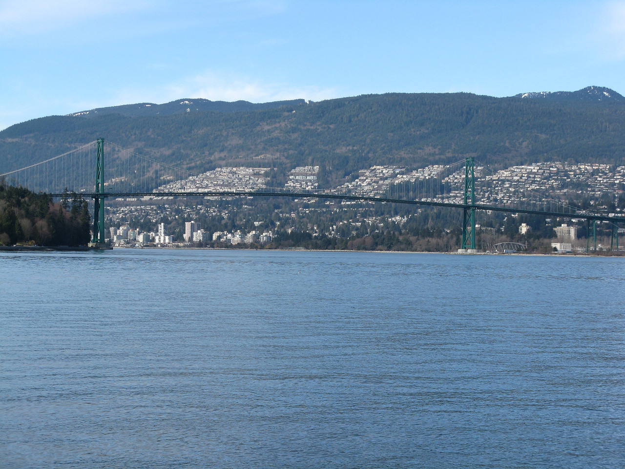 Lions Gate Bridge crosses Burrard Inlet between Stanley Park on the left and the suburb of Capilano on the right.