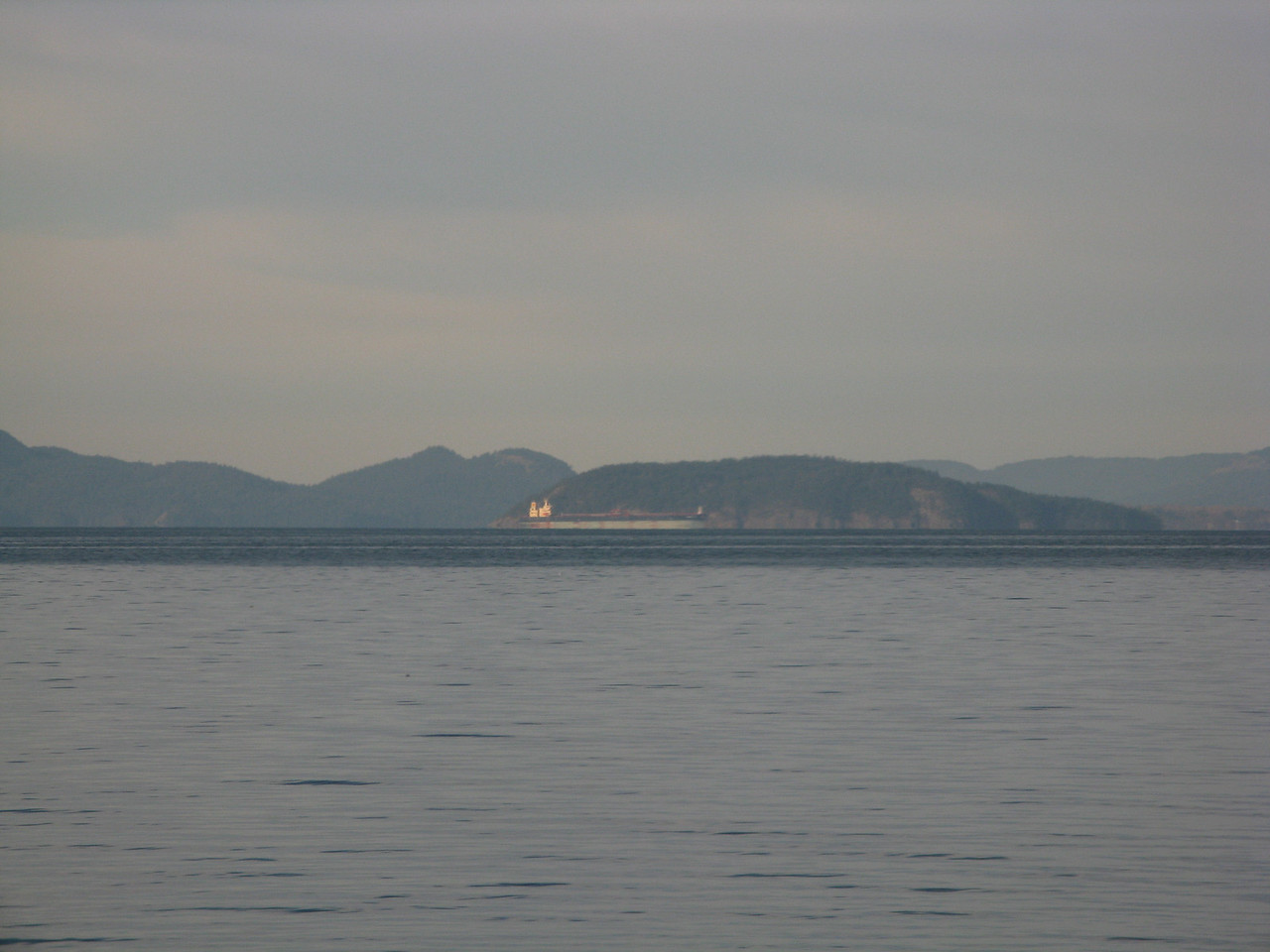 A ship heading north on Samish Bay south of Bellingham.