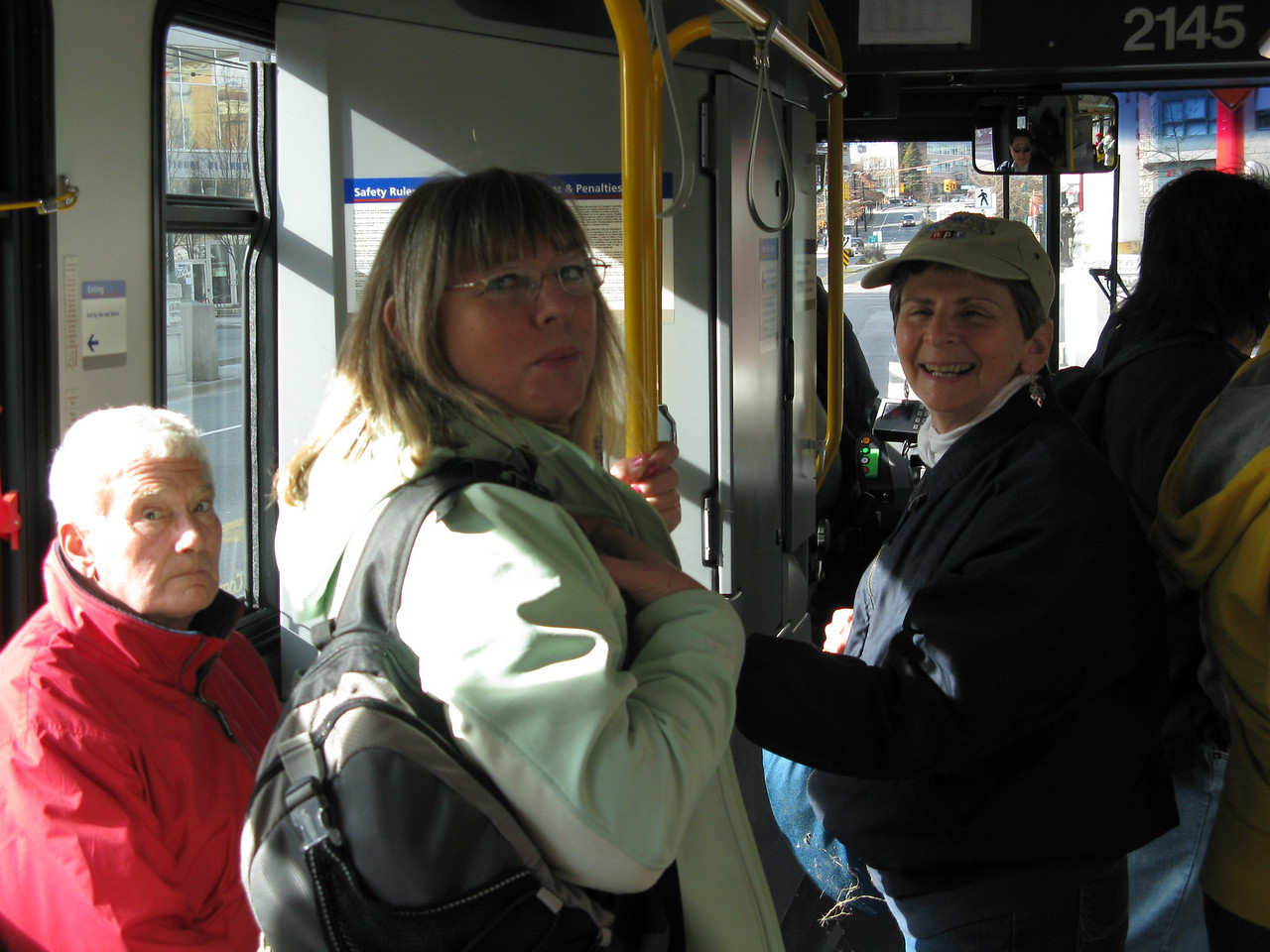 The bus was crowded on this Saturday afternoon.  (L to R) Carole and Sherry.  (The guy in the red jacket is a bystander.)