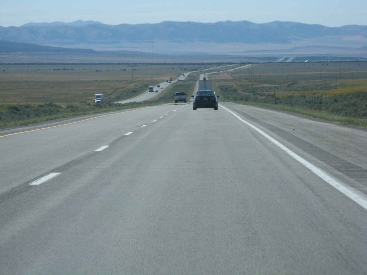 The interstate is a ribbon of highway stretching into the distance on I-84 in southern Idaho.  The speed limit is 75 mile per hour on the interstate highways in Idaho, Utah, Wyoming and Colorado.