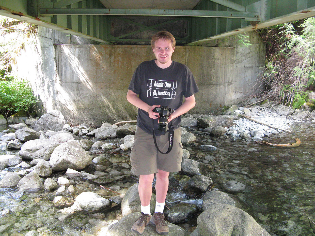 We climbed under the bridge in order to get to the falls.  A portrait of the photographer as a young man,.