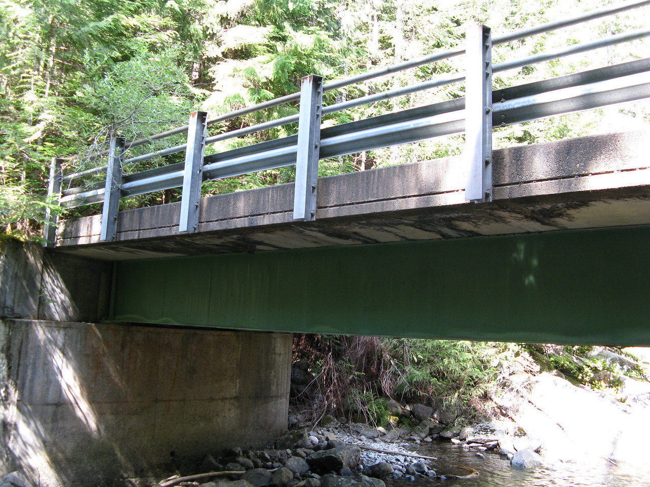 An incongruous sight:  a heavily built car bridge in the middle of nowhere on a hiking trail.