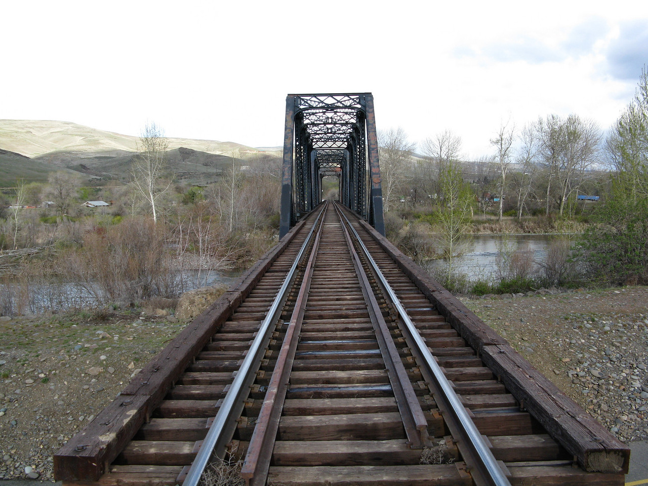 Looking east where the tracks cross the Yakima RIver on this old bridge.