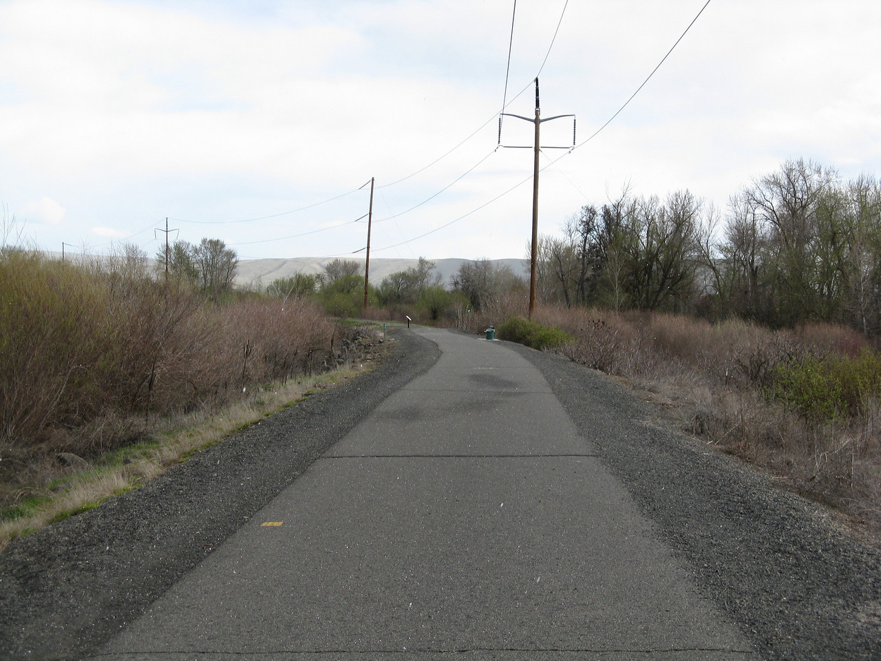 As we started our walk, it began to hail.  The white flecks in the image above are light hail falling on us.  We began the walk in a southbound direction on the Yakima Greenway.  The Yakima River is out of sight on the left.