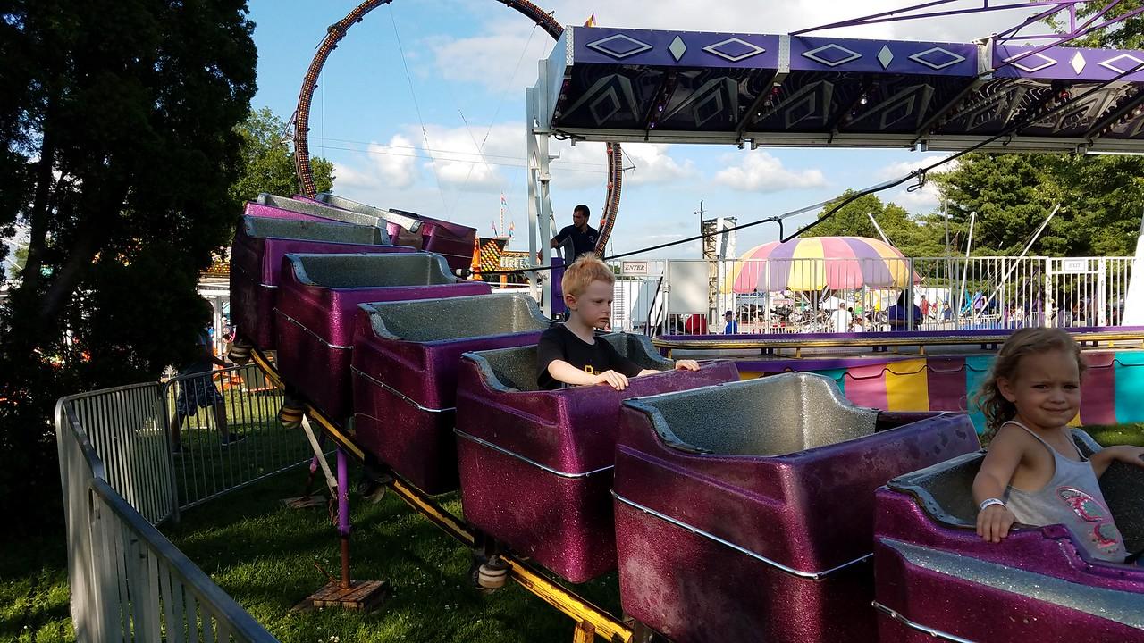 Milo riding the roller coaster