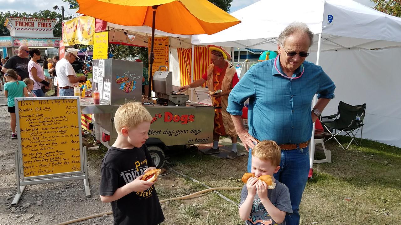 enjoying hotdogs