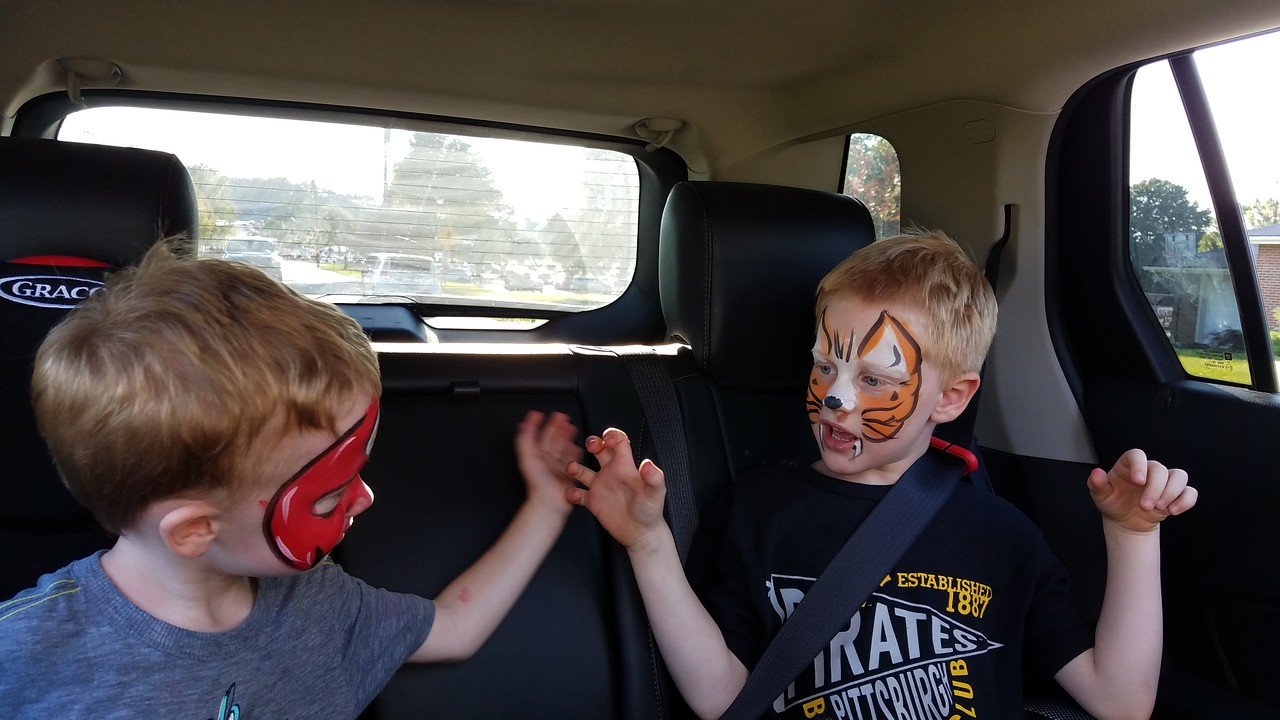 Two masked characters ride home from Balloon Quest