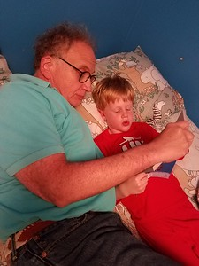 Reading with Grandpop before bed.