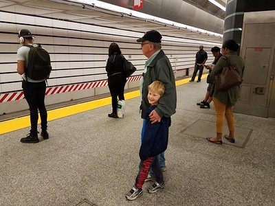 waiting for the Q subway train in the new station