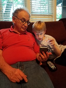 Milo checks out Grandpop's phone.