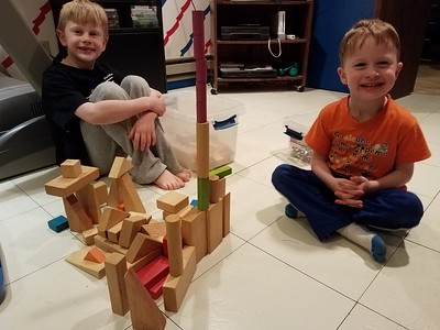 Two castle builders display their work