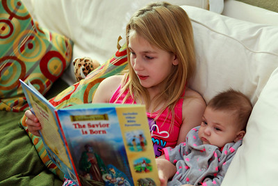 """Ariahla reading """"The Christmas Story"""" to all of us. Livaya listening intently."""