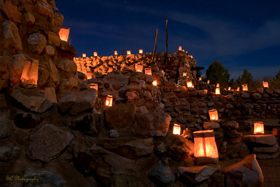 "The annual ""noche las luminarias"" at the Besh-Ba-Gowah archaeological park in Globe, AZ.  -- For one night each year, luminarias placed along the ruins' walls show the 700-year-old village in a different light. The 1,600 strategically placed paper lanterns outline the once-thriving community in red and orange, offering an uncommon view, one that's new even to visitors who have been there in daylight."