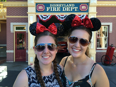 Kaitlin and Emma and their newly purchased Minnie Mouse ears.  You have to have them.  period.