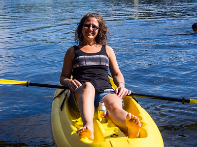 Lisa kyaking and enjoying her day in the sun on Lake Lawrence, Wa.
