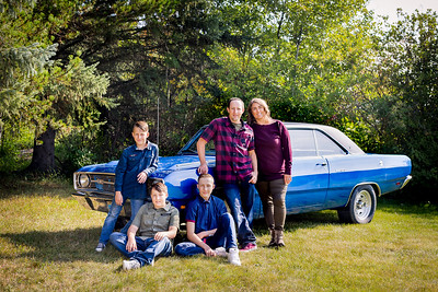 Loving that car - family photos near Sylvan Lake Alberta