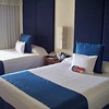 "Connecting rooms complete with monitors!<br /> <br /> For more information on Azul Sensatori, family vacations or a destination wedding, contact Romance@SandnSunVacations.com for more information. Please put ""Cherie"" in the subject line."