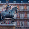 Plaza Mayor in Madrid  has residential buildings surrounding a statue of King Philip III, built in 17th century.