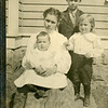 "Reta Roberts holding her brother, Ralph ""Bud"".<br /> With Ed's boys, Orval & Hartley.  Rita, Ralph,<br /> and Ed are siblings of Bessie Ellen Roberts."