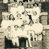 Front row from left, Bill, Lucile, and Glen Willsey.<br /> Top row second from left, Florence M. Waddell.<br /> Mary Ione (Sparks) Waddell on porch.<br /> This is the house where Kathryn Louise Willsey<br /> was born.  Trenton, MO