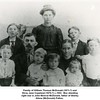 Family of William Thomas McDonald (1871-?) and<br /> Dicey Jane Copeland (1870-?) c.1902.  Boy standing<br /> right rear is John Monroe McDonald, father of Shirley<br /> Aliene (McDonald) Patton.