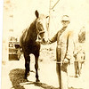 "Hartley W. Roberts and his grandson George<br /> ""Dick"" Williams.  The horse is Maude.<br /> Hartley's farm,  Nampa, ID  1920"