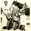 Kids from left, Kathryn Willsey, her cousin<br /> Dick Williams, her sister Maurice, and Dick's<br /> sister Orabelle.  Adults from left, Kathryn's<br /> grandmother Mina (Sparks) Willsey,<br /> and her grandfather Hartley Roberts.<br /> Nampa, ID  1920
