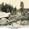 """Bess Willsey writes, """"The camp.  Ralph's cabin [left].  Trough from creek on mountain side to carry water<br /> to back door.  Lots handier than buying.""""<br /> Ralph is Bess' brother."""