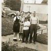 From left, Cherry McDonald, her mother Ruth holding<br /> Ruth's granddaughter Paula, Paula's mother, Shirley,<br /> and Ruth's husband, John.<br /> Boy in front is a neighbor friend.<br /> Bremerton, WA
