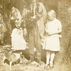 George Washington Sparks (1845-1933),<br /> and his great granddaughters Kathryn, left,<br /> and Maurice Willsey.  The dog is Bumper.<br /> Trenton, MO 1921