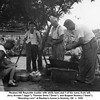 """Reuben Hill Reynolds (center with white hair) and 3 of his sons, from left,<br /> Jerry Arnold (""""Jiggs""""), Thomas Drew (""""Drew""""), and Eugene Nowery (""""Gene"""").<br /> """"Shucking corn"""" at Reuben's house in Hominy, OK  c. 1950"""